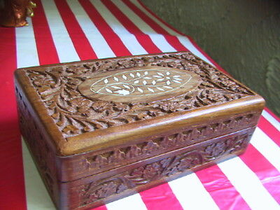 Wood carved box with bovine decorative material