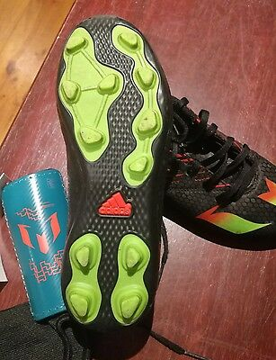 Adidas Messi soccer boots size US 4 and shin gaurds