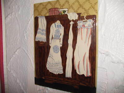 Large collectable Enamelled tile portraying a Victorian lady bedroom wardrobe