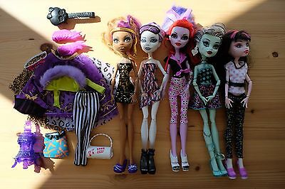 Collection of five Monster High dolls and accessories