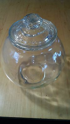 "Antique glass canister marked AUG. 28 1900 on the lid  8"" tall"