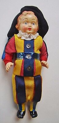 "Vintage 4 ¾""  celluloid male doll.  Cotton uniform with ribbon stripes and sequi"