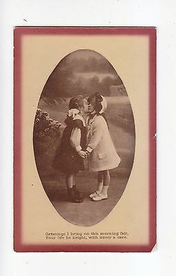 CHARMING POSTCARD IN AN OVAL FRAME OF TWO  GIRLS HAVING A KISS-MISCH & CO No 519
