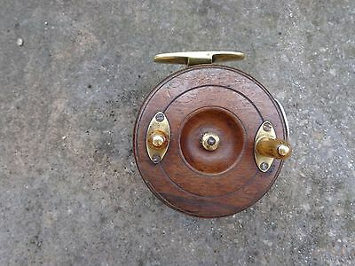 Restored Vintage Wooden Fishing Reel with Brass Fitings.