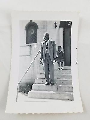 1955 Snapshot Photograph African-American Man On Steps Black & White S01