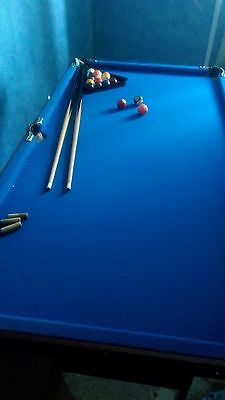 Large snooker table with balls and cues, good condition.