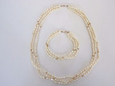 Seed pearl necklace and matching bracelet with gold bead accents.
