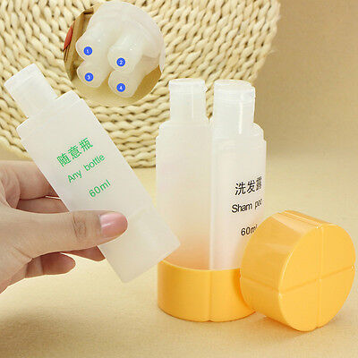 4 in 1 Travel Set Containing Shampoo Shower Bag Refillable Empty Bottles