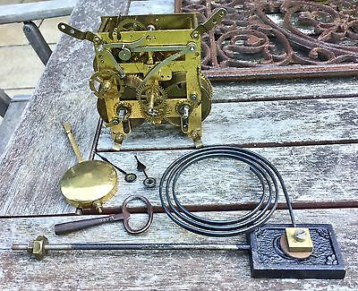 Antique Striking Clock Movement With Pendulum, Key & Gong.
