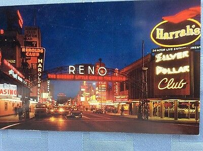 Postcard The Famous Reno Arch and View of Colorful Virginia St.