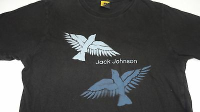 Jack Johnson shirt. Music small