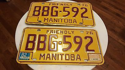 1976 Friendly Manitoba license plate pair yellow & red Canada Auto BBG 592