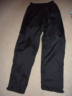Unisex Puma black waterproof trousers, size YL (Approx age 14)