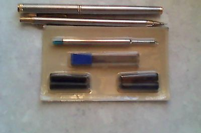 Silver fountain pen and pencil set and refills