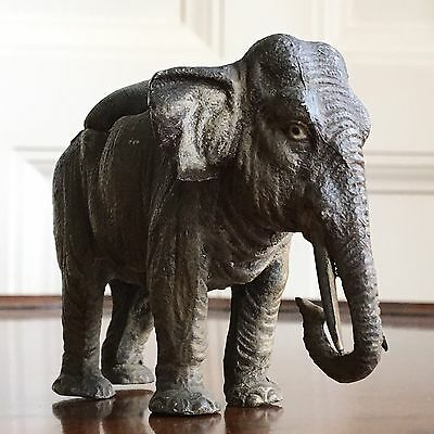 A Novelty Victorian Painted Metal Elephant Pin Cushion, c.1890. 7.5cm High.