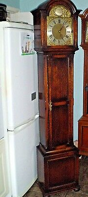 A chiming oak case Grandfather clock by EMBEE the great German maker Circa 1930.