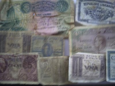 12 Very Old and mostly very scruffy world bank notes.Several from WWII