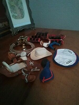 lot of breyer acessories and tack ,pack saddle , shipping boots ect