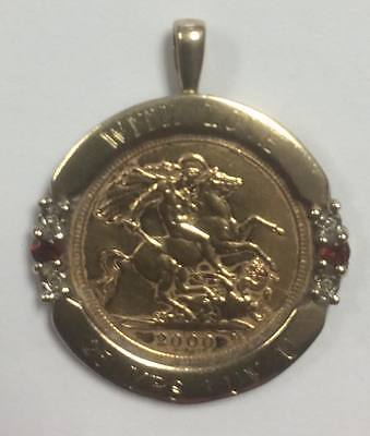 Half Sovereign (Year 2000) in 9ct gold mount with diamond and garnet