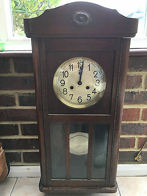Antique wall hung pendulum clock with chime