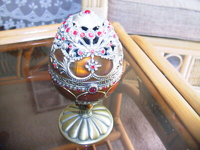 Faberger style ruby stones and enamelled musical egg
