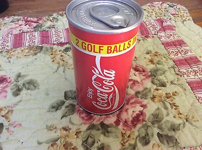 vintage 1992 coca-cola can with two golf balls sealed!