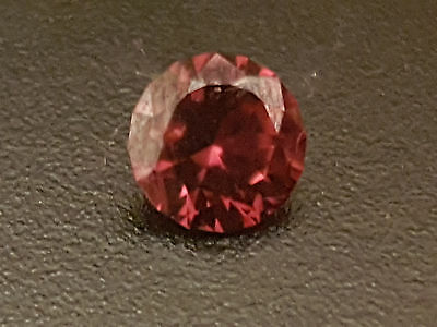 Natural Earth mined reddish brown round cut zircon 1.38ct