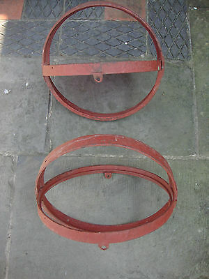 Pair antique reclaimed cast iron opening round windows