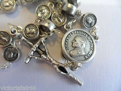 Metal Rosary beads. Pope Benedict and Pope John stamped on each bead.