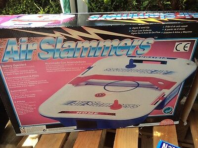small air hockey, air slammers game