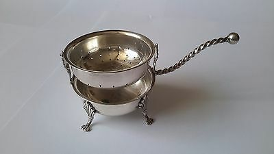 A beautiful vintage silver plated tea strainer and drip bowl