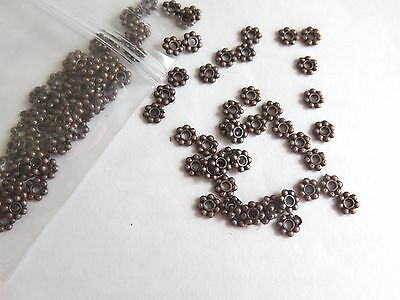 Pk 100 of 4mm Antique Copper/Bronze metal Daisy Spacer