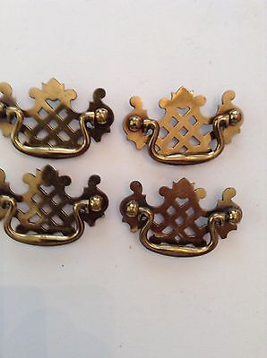 Four bright brass Chippendale furniture pulls