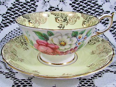 Paragon Pale Yellow Gold Scroll Work Floral Tea Cup And Saucer
