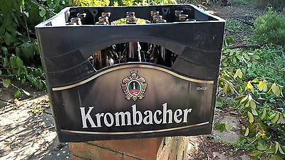 Krombacher beer crate with empty bottles