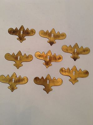 Eight Chippendale brass key plates