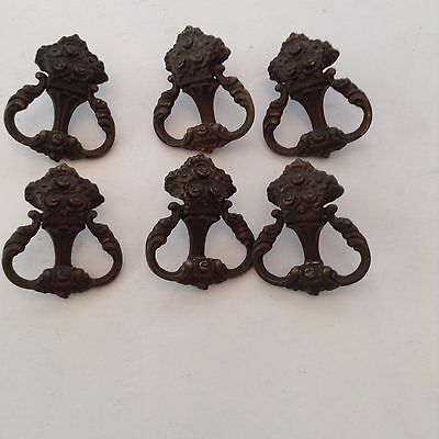 Set of six older brass pulls with a unique decorative look for furniture