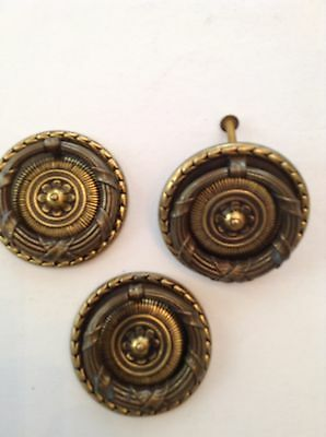 Three large dark brass classic ring pulls for furniture