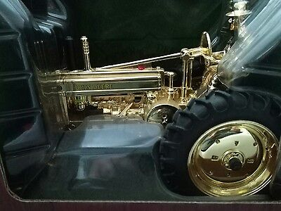 New in box John Deere Gold Model A with Man 100th anniversary