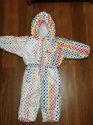 Multi-coloured polka-dot Bambini child one-piece ski suit.