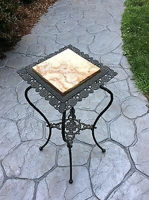 Vintage Black Wrought Iron Ornate Plant Stand with marble top and shelf