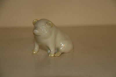 "Irish Belleek china pig, cream with yellow ""points"" on ears, tail and feet"