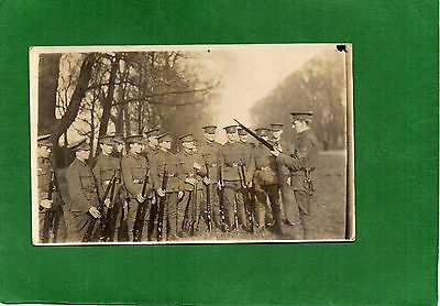 WW1 Real Photo Postcard Soldiers receiving Rifle Instruction