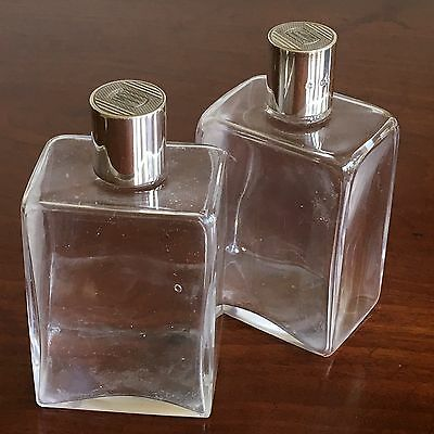 Pair Of Good Quality Gentleman's Silver And Glass Toiletry Bottles, London 1947.