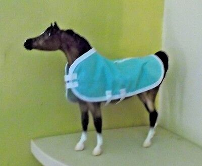 "BREYER Molding Co horse with cotton ""blanket"" and white hooves"