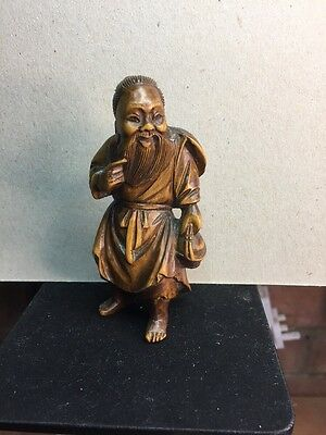 "Boxwood Okimono ""Ebisu"" One Of The Seven Japanese Gods Of Good Fortune"