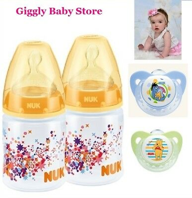 Nuk Baby Bottles 2x150ml Yellow Decorated 0-6m Pack Plus 2x Nuk Soothers 0-2m