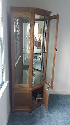 Two (2) Solid Oak Diagonal Lighted Corner Curio Glass Cabinets