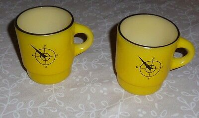 Pair of Vintage Yellow Fire King Coffee Mugs with Compass Symbol