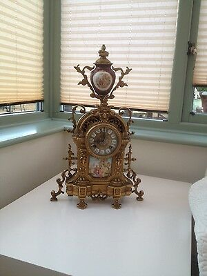 French style Ormolu chiming clock with porcelain pediment (key required)
